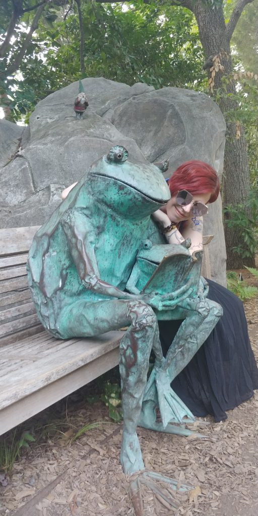 Wendy reads with a froggy friend